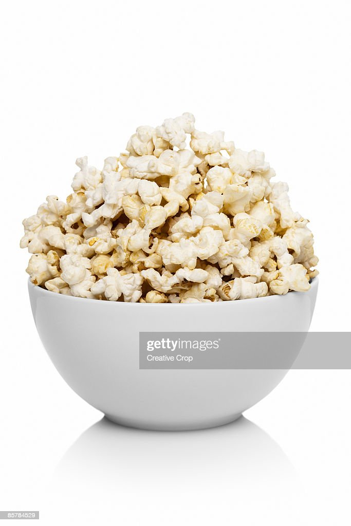 White ceramic bowl full of popcorn