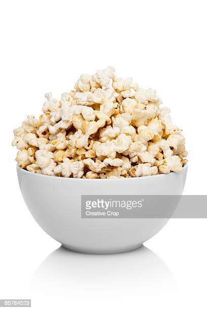 White ceramic bowl full of popcorn