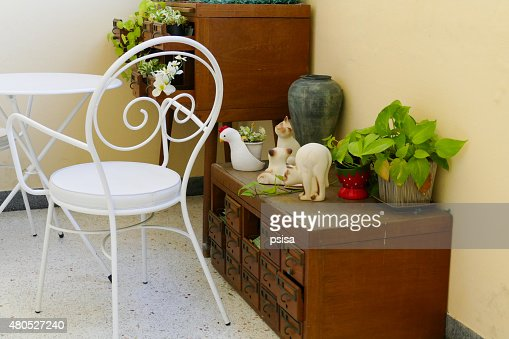white chair, desk and plant decorating on wooden desk drawer : Stock Photo