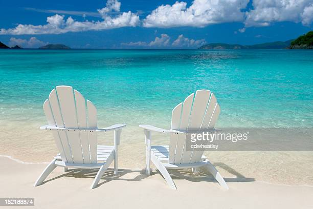 white chairs on the Caribbean beach