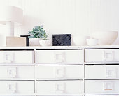 A white chest of drawers
