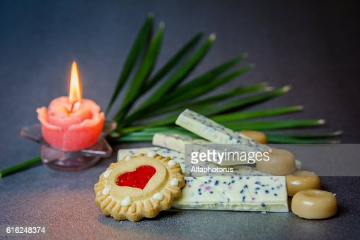 white chocolate cookies candle on a dark background. : Stock Photo