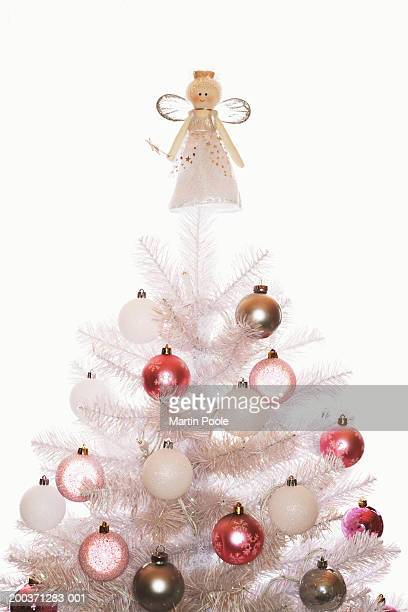 White Christmas tree with baubles and angel, high section, close up