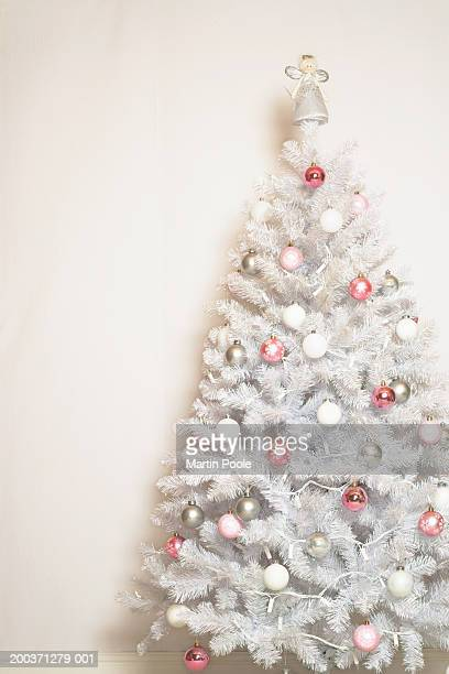 White Christmas tree with baubles and angel on top