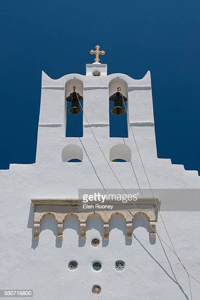 White church building with bell tower; Sifnos, The Cyclades, The Greek Islands, Greece