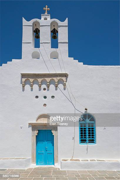 White church building with bright blue door; Sifnos, The Cyclades, The Greek Islands, Greece
