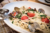 Pasta with clam and tomato.