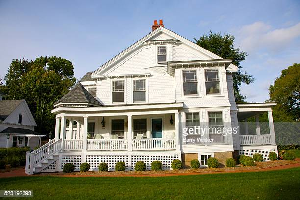 White clapboard house with large porch, Cape Cod