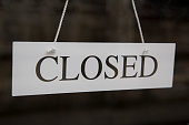 White Closed Sign on Shop Door