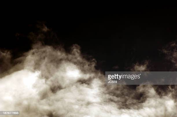 White clouds of smoke on a black background