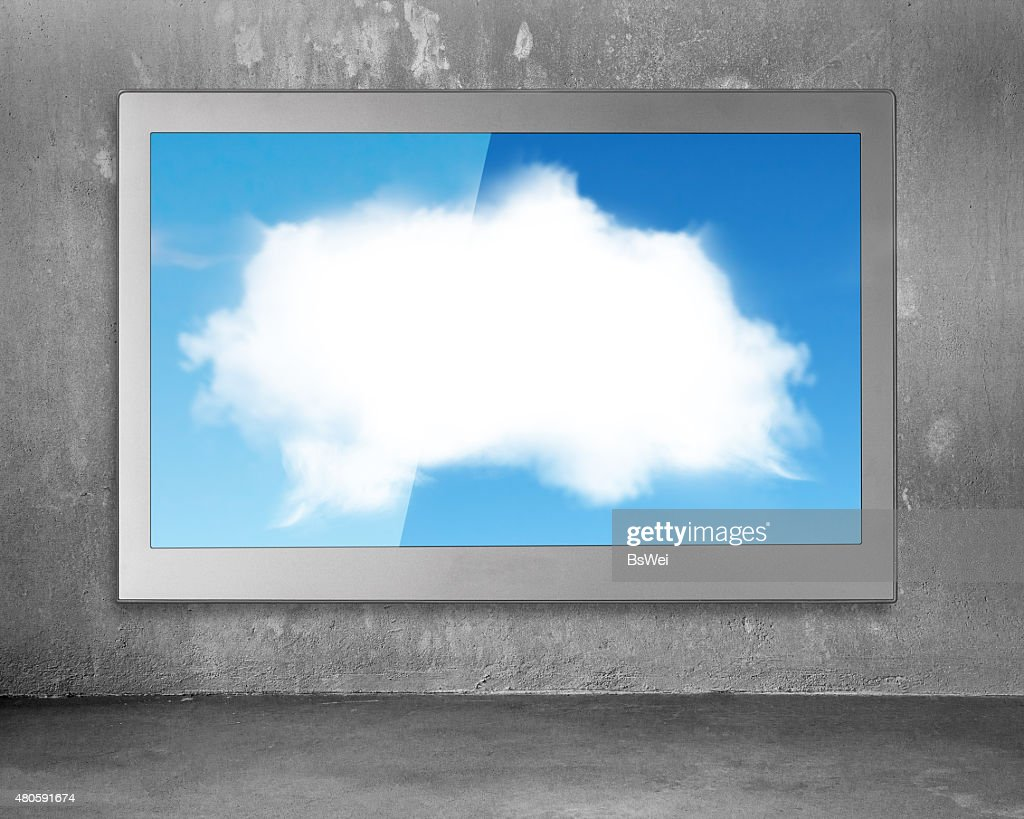 White clouds sky image on wide flat TV screen : Stock Photo
