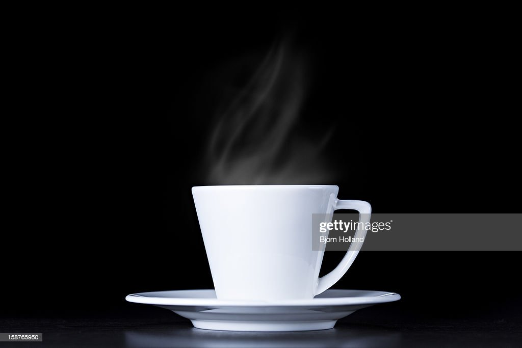 White coffee cup and steam on black background : Stock Photo