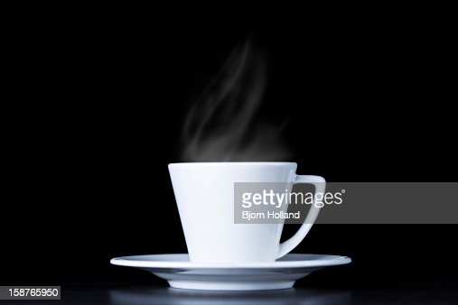 White coffee cup and steam on black background
