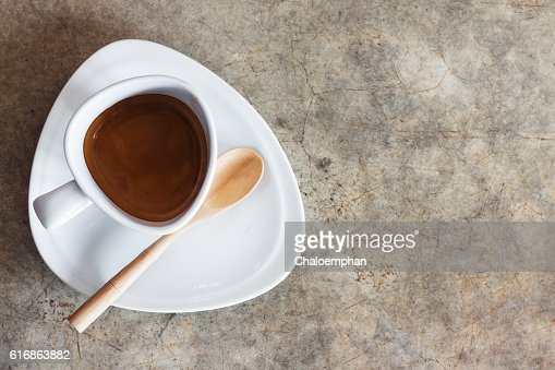 White Coffee cup on concrete table with copy space. : Stock Photo