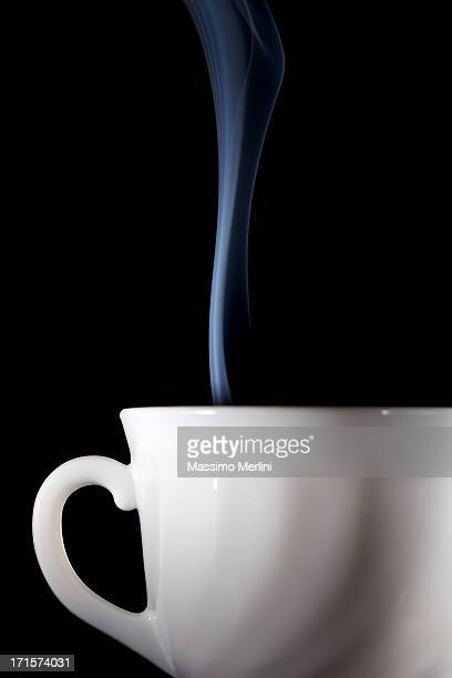 White coffee mug with steam coming off the top.