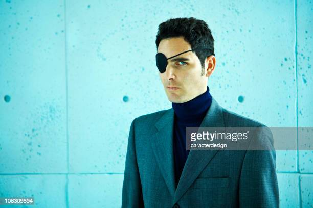 White collar crime: businessman with eye patch