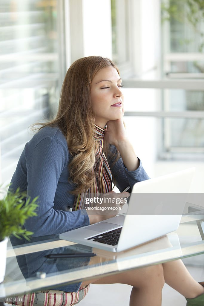 White collar worker in her office : Stock Photo