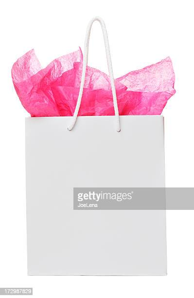 White colored gift back, with pink paper sticking out