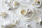 White colored still life with confectionery and sugar cubes