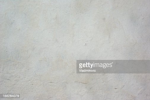 White concrete wall background with little crack