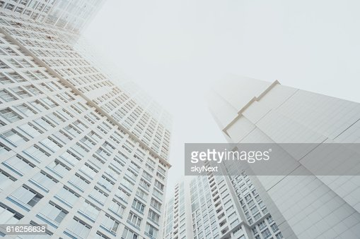 White contemporary residential skyscraper apartment building, two housing body : Stock Photo