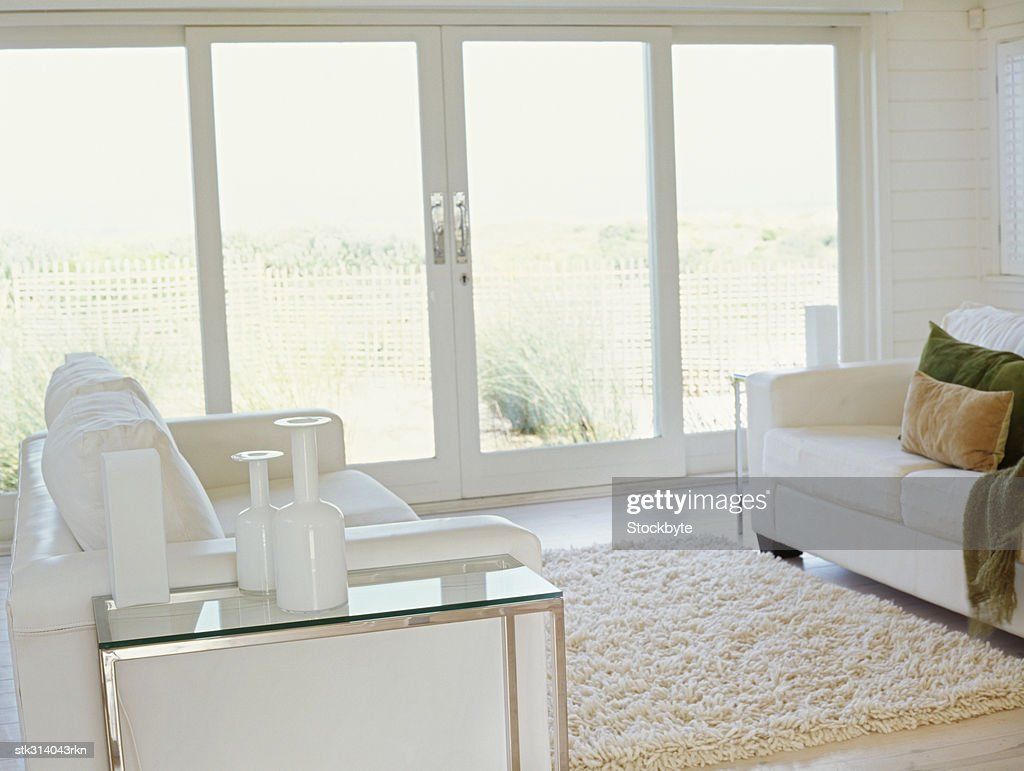 white couch and a rug in a living room : Stock Photo