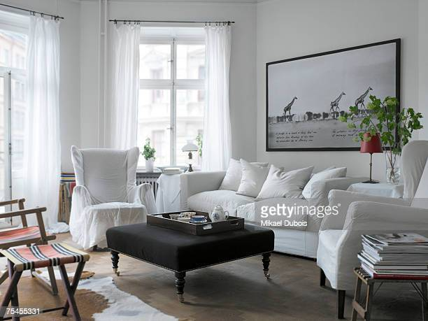A white couch in a living room.
