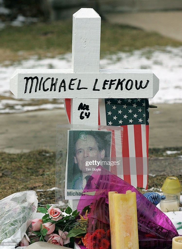A white cross with a photo of Michael Lefkow is seen as part of a memorial outside of the US District Judge Joan Lefkow's home March 11, 2005 in Chicago, Illinois. Lefkow's husband Michael Lefkow and mother, Donna Humphrey, were murdered February 28 in the Lefkow?s home. Investigators have a DNA match found on a cigarette butt at the crime scene linking a Chicago citizen Bart Ross to the double murder. Ross, who allegedly claimed responsibility for the crime via numerous notes, committed suicide in West Allis, Wisconsin on March 9.