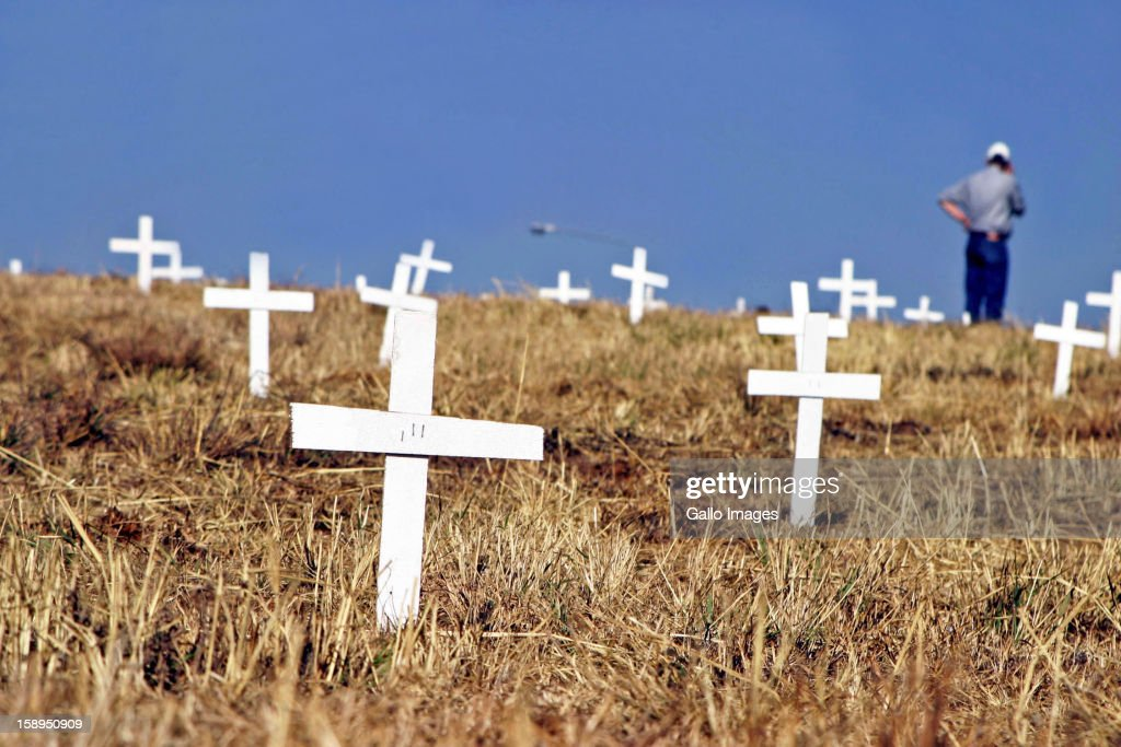 1500 white crosses have been planted next to the John Vorster offramp near the N1 in Centurion as evidence and as protest for the 1500 people who have died due to farm attacks, shown here on July 27, 2003 in Pretoria, South Africa.