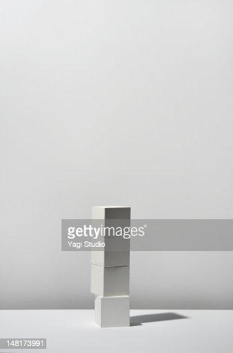 White Cube stacking on white background