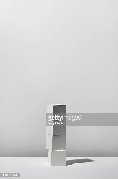 White Cube stacking on white background