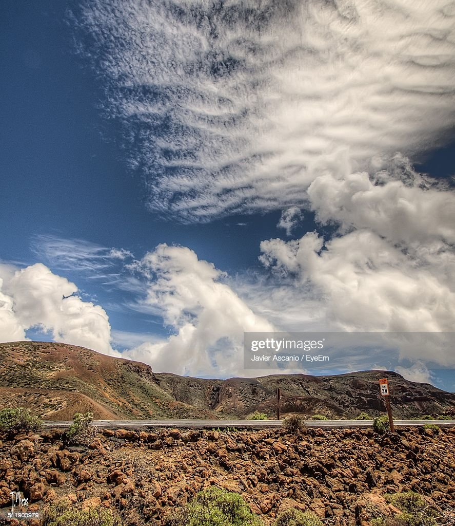White cumulus clouds over mountain