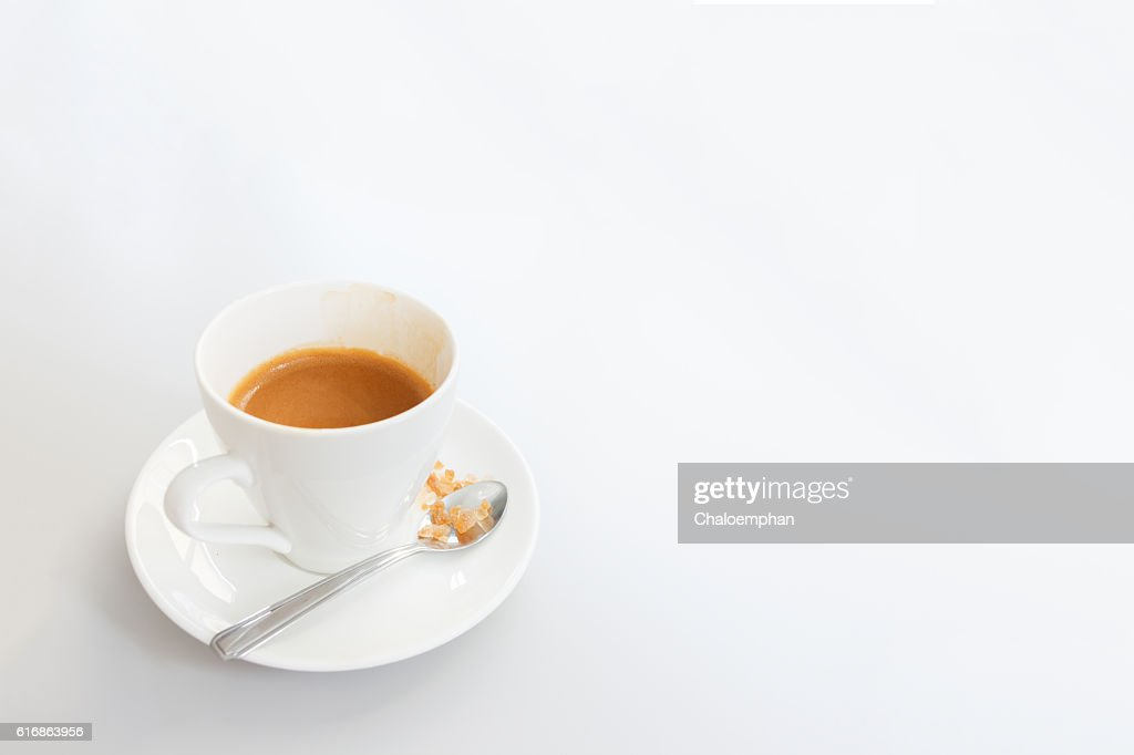White cup of coffee on white wood table : Stock Photo