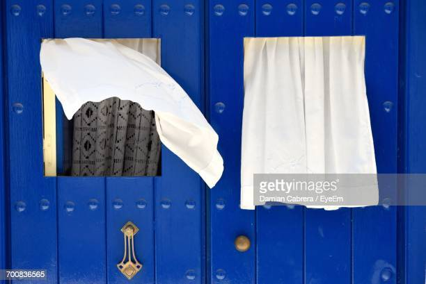 White Curtains On Blue Wooden Door
