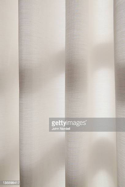 White curtains with light filtering through