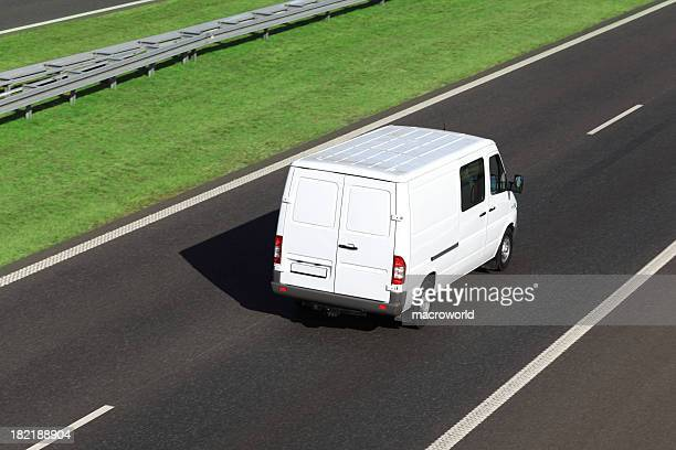 White delivery van driving on a highway