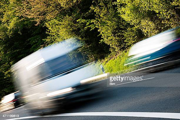 White Delivery Van Speeding on Country Road