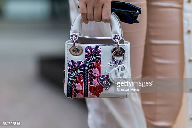A white Dior bag outside Misha Collection at MercedesBenz Fashion Week Resort 17 Collections at Carriageworks on May 16 2016 in Sydney Australia