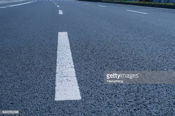 White dividing line on the road surface