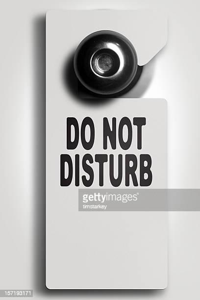 White do not disturb sign on door knob