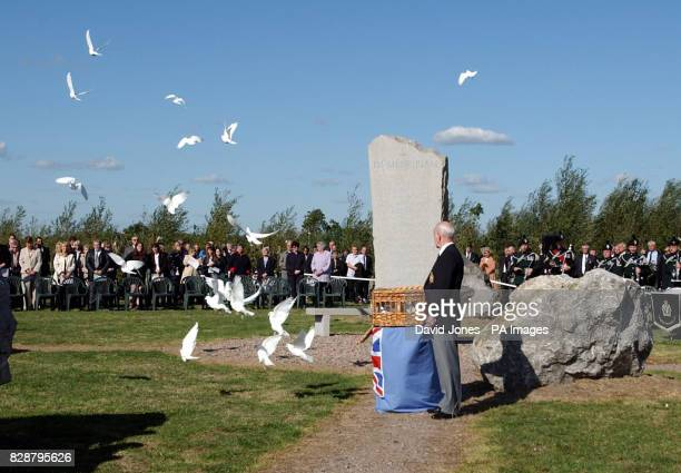 White doves are released at the dedication of the Ulster Ash Grove at the National Memorial Arboretum near Lichfield Staffordshire The site a stone...