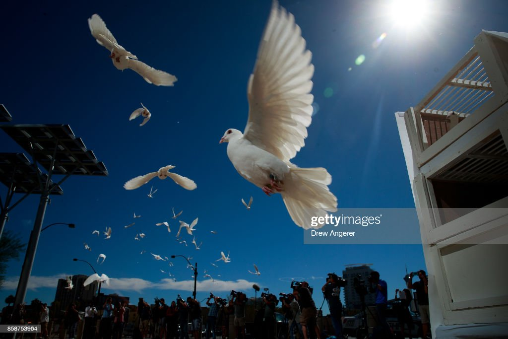 58 white doves are released in honor of the victims of last Sunday's mass shooting, at the culmination of a faith unity walk at Las Vegas City Hall on October 7, 2017 in Las Vegas, Nevada. On October 1, Stephen Paddock killed at least 58 people and injured more than 450 after he opened fire on a large crowd at the Route 91 Harvest country music festival. The massacre is one of the deadliest mass shooting events in U.S. history.
