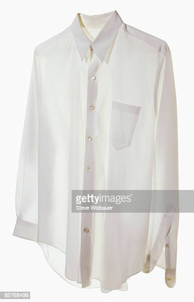 White dress shirt floating and buttoned for work