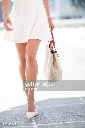 White dressed woman with handbag