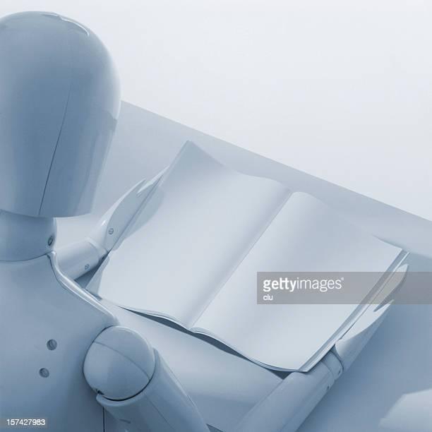 White dummy puppet reading empty book