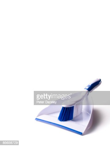 White dust pan and brush on white background. : Stock Photo