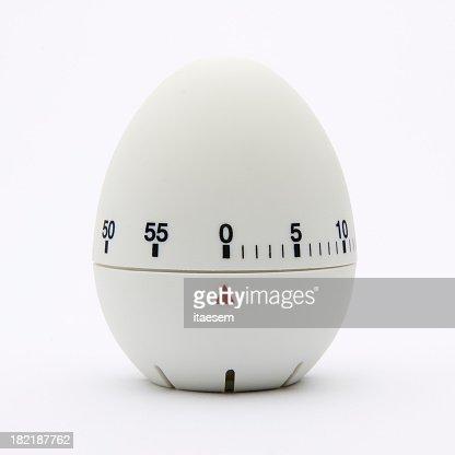 White egg-shaped kitchen timer isolated on white background