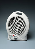 white electric heater on gray background - isolated - closeup