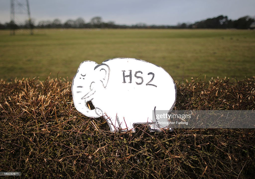 A white elephant placard, placed by Joe Rukin from the Stop the HS2 Campaign, sits in a hedegrow near to the planned location of the new HS2 high speed rail link as it passes by the village of Hoo Green on January 28, 2013 in Knutsford, United Kingdom. The government has today released details of the next phase of the GBP 32 billion HS2 high-speed rail network, which will link Manchester and Leeds.