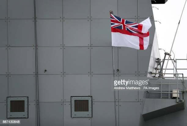 A white ensign flies from the Forward Island onboard HMS Queen Elizabeth ahead of her commissioning ceremony on Thursday in Portsmouth